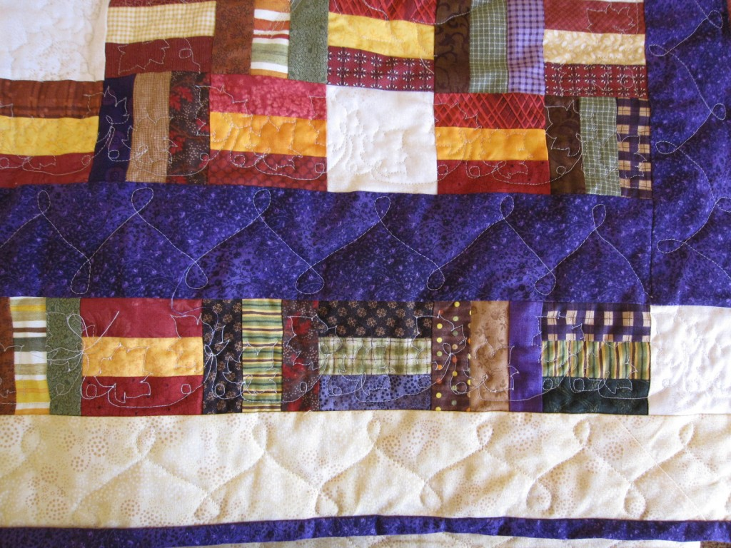 Maple leaves and loops on Sonias quilt