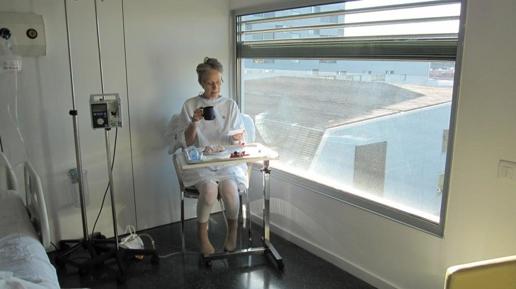 Sonja having breakfast by the window